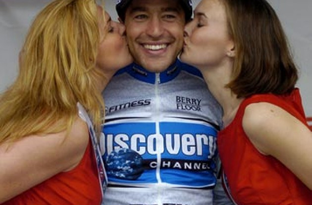 Jose Rubiera of Discovery receives kisses from the podium girls for being named King of the Mountains. Photo copyright Casey Gibson.