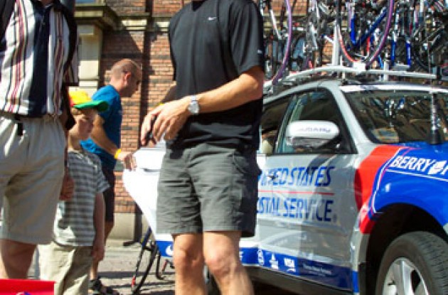 USPS team director Dirk Demol has a chat with a friend shortly before the start in Odense. Photo copyright Roadcycling.com.