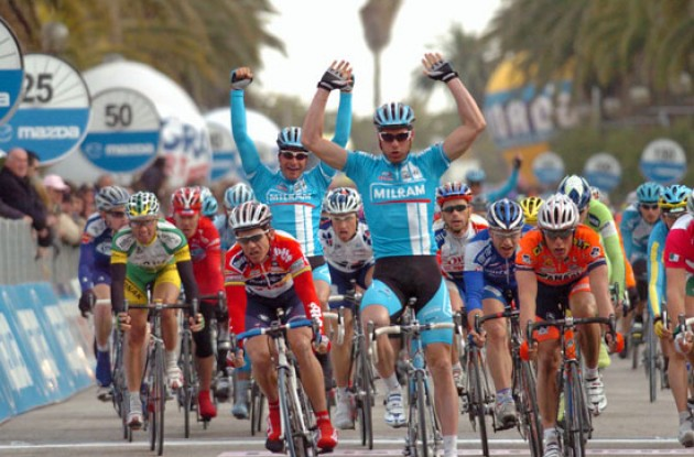Petacchi takes the win and Zabel celebrates. Photo copyright Fotoreporter Sirotti.