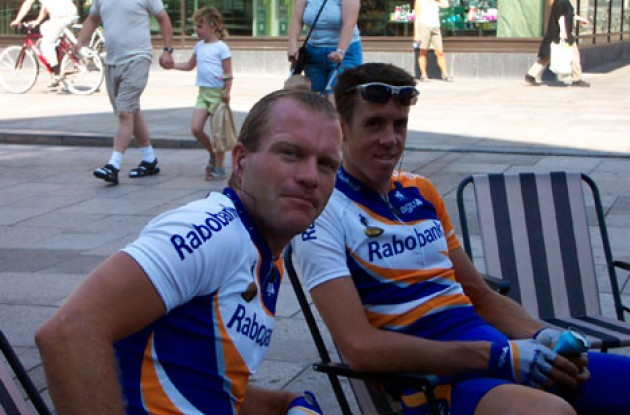 Two happy riders from the Rabobank vielerploeg take a rest. Photo copyright Roadcycling.com.