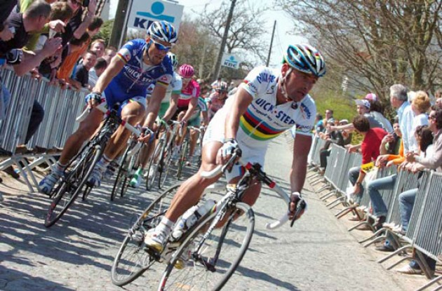 Bettini climbs closely followed by Boonen.