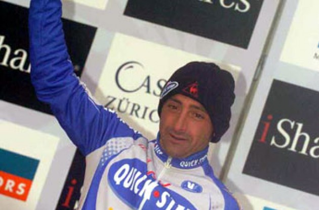 Bettini on the podium. Photo copyright Fotoreporter Sirotti.