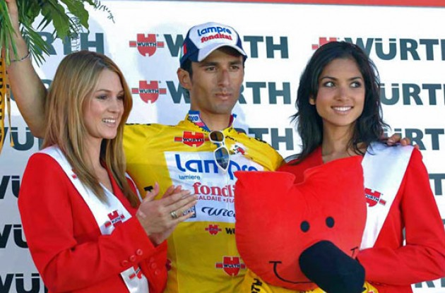 Race leader Daniele Bennati on the podium. Photo copyright Fotoreporter Sirotti.