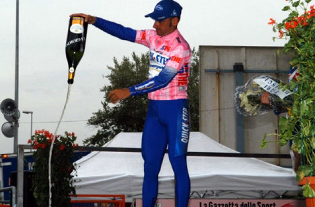 Bettini makes a nice gesture on the podium. I'm not in the mood for champagne. Photo copyright Fotoreporter Sirotti.