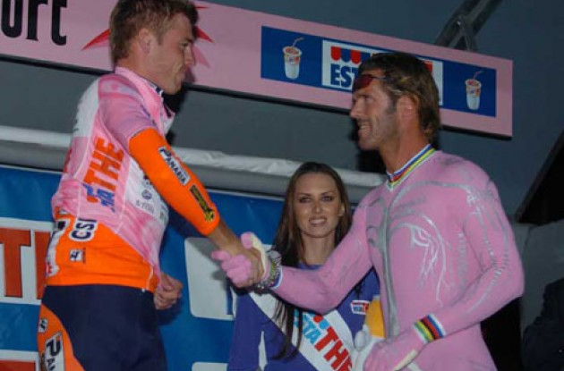 Giro prologue winner Brett Lancaster meets Mario Cipollini (retired Lion King). Photo copyright Fotoreporter Sirotti.