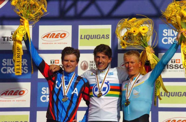 Top 3 on the podium in Salzburg, Austria: Cancellara, Zabriskie and Vinokourov. Photo copyright Fotoreporter Sirotti.