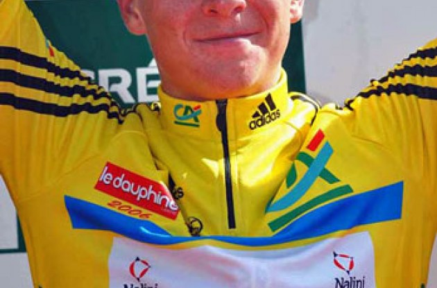Fabian Wegmann wearing yellow on the podium. Photo copyright Fotoreporter Sirotti.