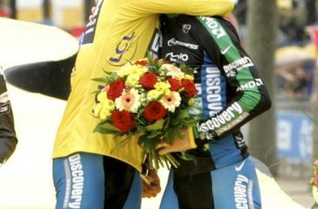 "We did it! Thanks mate! Contador hugs Leipheimer in Paris. Photo copyright <A HREF=""http://www.photoshelter.com/usr-show?U_ID=U0000yEwV90OAoAE"" TARGET=""_BLANK"">www.BenRossPhotography.com</A>."