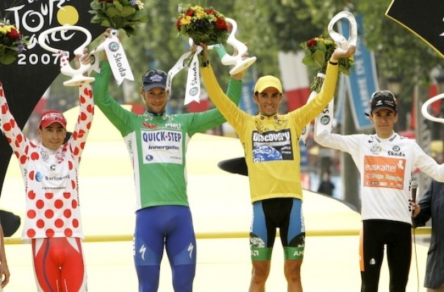 "Yellow, green, red and white jerseys on the podium. Photo copyright <A HREF=""http://www.photoshelter.com/usr-show?U_ID=U0000yEwV90OAoAE"" TARGET=""_BLANK"">www.BenRossPhotography.com</A>."