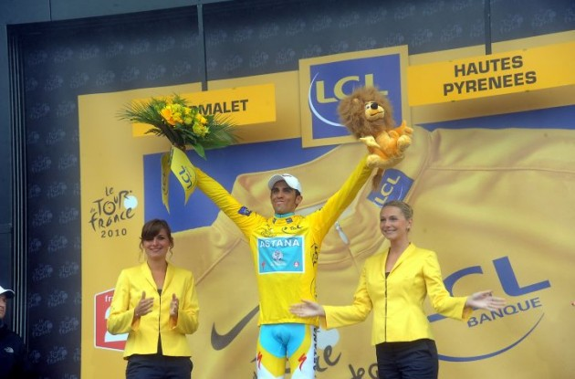 Alberto Contador celebrates his Tour lead on the podium. Photo copyright Fotoreporter Sirotti.