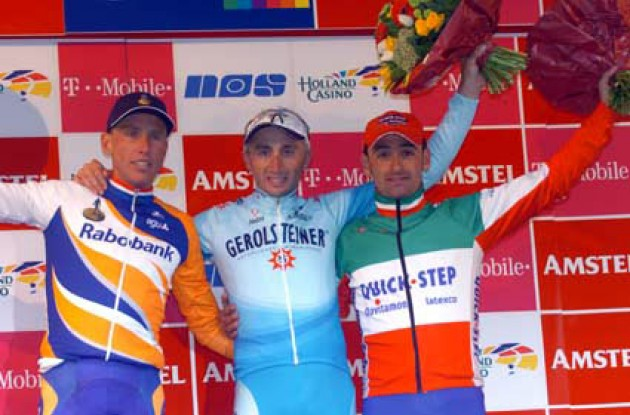The top three on the podium. From left to right Michael Boogerd (Rabobank), Davide Rebellin (Gerolsteiner) and Paolo Bettini (Quick Step). Photo copyright Fotoreporter Sirotti.