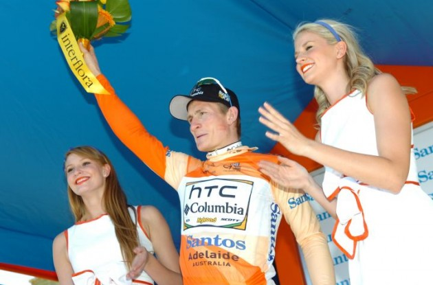 Andre Greipel celebrates with the beautiful podium girls. Photo copyright Fotoreporter Sirotti.