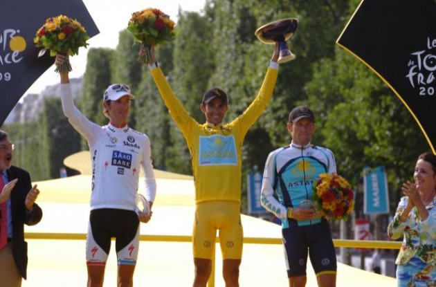 Top 3 on the podium. Alberto Contador (Team Astana), Andy Schleck (Team Saxobank), and Lance Armstrong (Team Astana). Photo copyright Fotoreporter Sirotti.