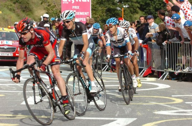 Team BMC Racing's Cadel Evans leads Andy Schleck (Team Leopard-Trek) up the Alpe d'Huez climb. Photo Fotoreporter Sirotti.