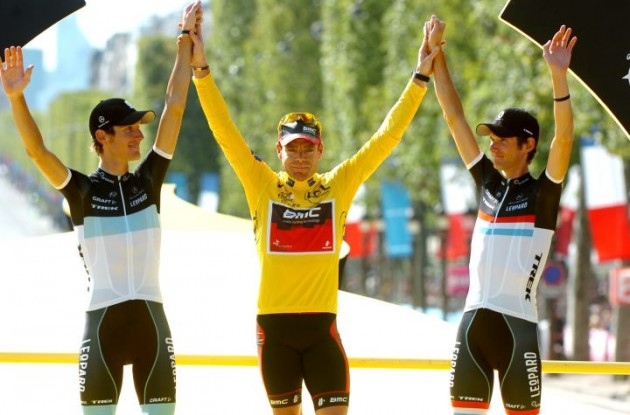 Cadel Evans, Andy Schleck and Frank Schleck on the Tour de France podium in Paris. Will they be on the final podium of the 2011 USA Pro Cycling Challenge as well? Photo Fotoreporter Sirotti.