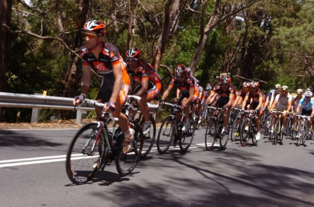 Caisse d'Epargne leads the peloton up a warm climb. Photo copyright Fotoreporter Sirotti.
