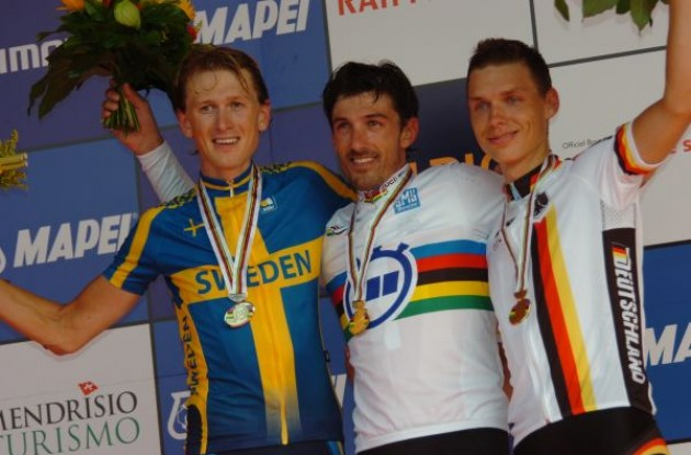 Fabian Cancellara, Gustav Erik Larsson amd Tony Martin on the podium. Photo copyright Fotoreporter Sirotti.