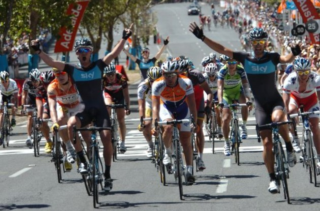 Chris Sutton wins and Team Sky teammate Greg Henderson celebrates the win. Photo copyright Fotoreporter Sirotti.