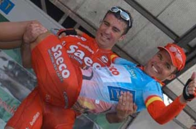 Quaranta and Celestino celebrate on the podium. Photo copyright Fotoreporter Sirotti