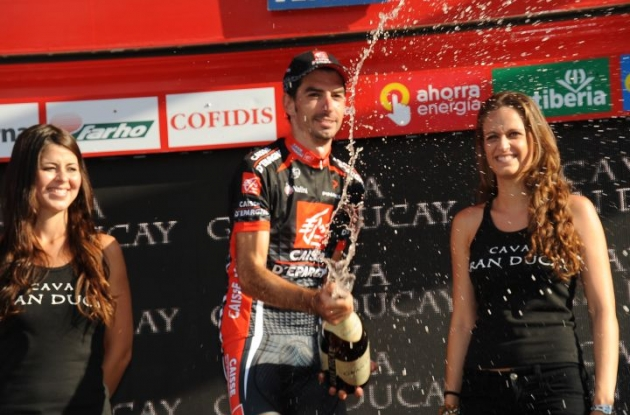 David Lopez Garcia celebrates his Vuelta stage win on the podium. Photo copyright Fotoreporter Sirotti.