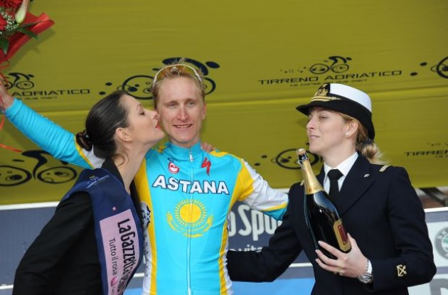 Enrico Gasparotto (Team Astana) on the podium with the cute Italian podium girls. Photo copyright Fotoreporter Sirotti.