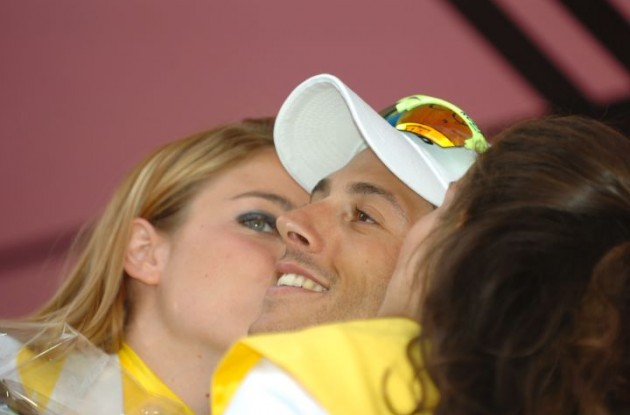Eros Capecchi gets a treat from the beautiful podium girls. Photo Fotoreporter Sirotti.