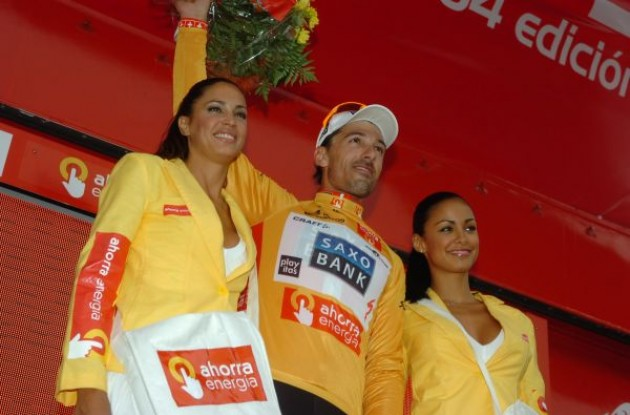 Fabian Cancellara on the podium with the nicely tanned podium girls. Photo copyright Fotoreporter Sirotti.