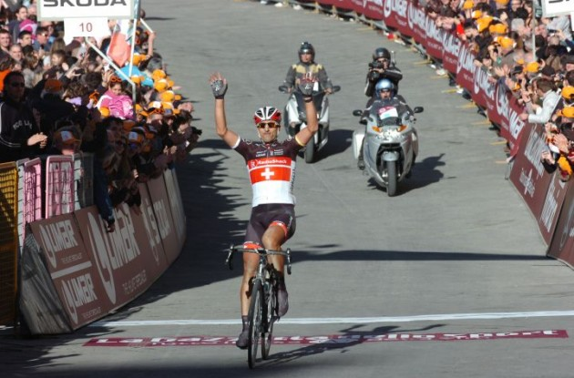 Team RadioShack-Nissan's Fabian Cancellara victorious in Monte Paschi Strade Bianche 2012 ahead of   Maxim Iglinsky of Team Astana and Team Varnese Vini-Selle Italia's Oscar Gatto. Photo Fotoreporter Sirotti.