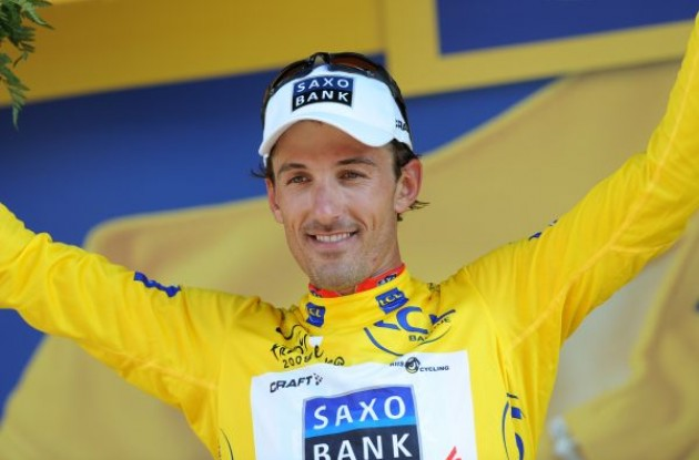 Fabian Cancellara (Team Saxo Bank) on the podium in yellow. Photo copyright Fotoreporter Sirotti.