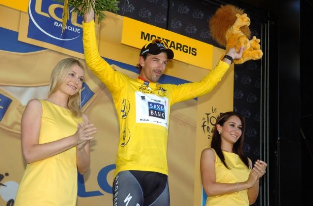 Fabain Cancellara has some quality time with the podium girls on the Tour de France podium. Can someone please send me the phone number of the left one? Wow! You're welcome to drop by! Photo copyright Fotoreporter Sirotti.