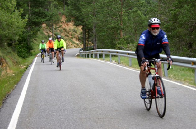 Fifty nine year old Don Anderson leads bunch up a long climb in Pyrenees. Photo by Thomson Bike Tours.