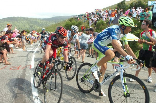 Team Liquigas-Cannondale's Ivan Basso on his way towards Plateau de Beille closely tailed by Cadel Evans (Team BMC Racing). Photo Fotoreporter Sirotti.