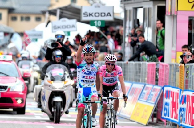 Team Androni's Jose Rujano climbs to stage 13 victory in 2011 Giro d'Italia closely tailed by Alberto Contador who significantly increases his overall Giro d'Italia lead. Photo Fotoreporter Sirotti.