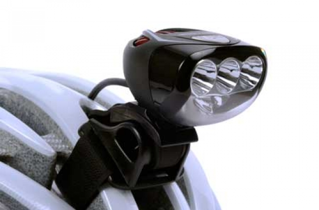 Light and Motion Seca 700 Race LED front bike light mounted on a helmet.