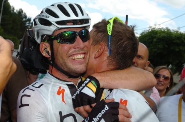 Team HTC-HighRoad's Mark Cavendish hugs teammate Tony Martin after one of his many stage wins in the 2011 Tour de France. Photo Fotoreporter Sirotti.