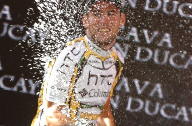 Team HTC-Columbia's Mark Cavendish celebrates his 2nd Vuelta stage win on the podium in Burgos. Photo copyright Fotoreporter Sirotti.