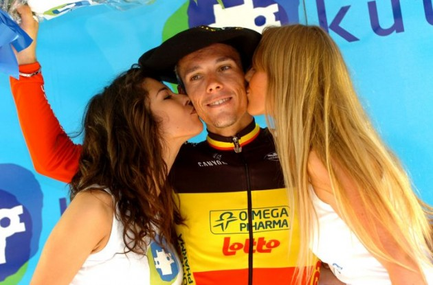 Clasica San Sebastian winner Philippe Gilbert gets som sweet attention from the podium girls. Photo Fotoreporter Sirotti.