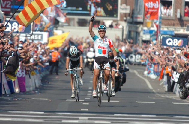 Team Omega Pharma-Lotto's Philippe Gilbert powers to victory in Liege-Bastogne-Liege ahead of Frank Schleck and Andy Schleck of Team Leopard-Trek. Photo Fotoreporter Sirotti.