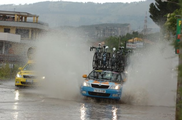 Team Garmin car transitioning from wet to even wetter conditions in today's stage of the Giro d'Italia. Lots of water indeed. Watch riders swim through today's stage in our video section at www.roadcycling.com/video . Photo copyright Fotoreporter Sirotti.