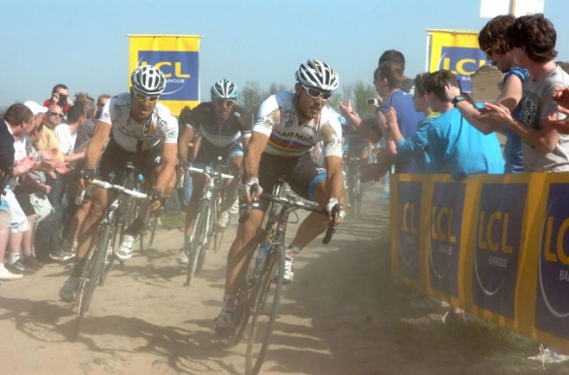 World Champion Thor Hushovd leads last year's Paris-Roubaix winner Fabian Cancellara on one of today's paves. Photo Fotoreporter Sirotti.