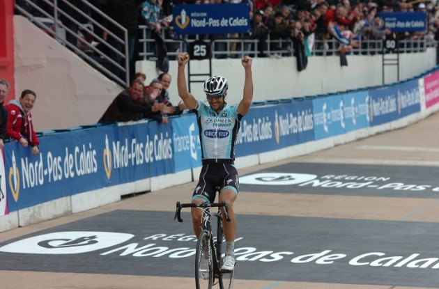 Team Omega Pharma-QuickStep's Tom Boonen powers to solo victory in Paris-Roubaix ahead of Sebastien Turgot of Team Europcar and Team BMC Racing's Alessandro Ballan. Photo Fotoreporter Sirotti.