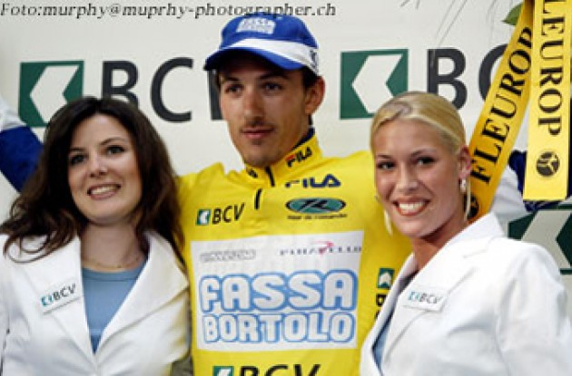 Cancellara on the podium. (Wow - do they have white teeth!) Photo copyright IMG (SUISSE) SA.