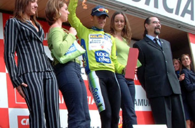 Alejandro Valverde celebrates his overall win on the podium in Spain.