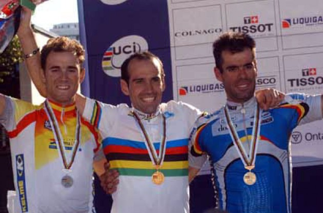 World Champion Igor Astarlia on the podium along with Valverde and Van Petegem. Photo copyright Fotoreporter Sirotti.